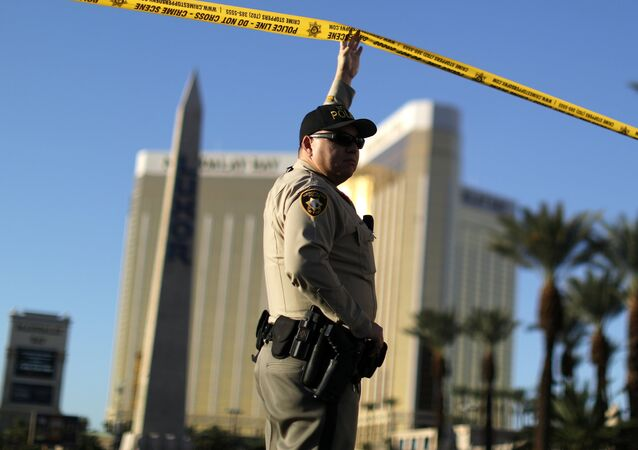 A police officer stands in front of the closed Las Vegas Strip next to the site of the Route 91 music festival mass shooting outside the Mandalay Bay Resort and Casino in Las Vegas, Nevada, U.S