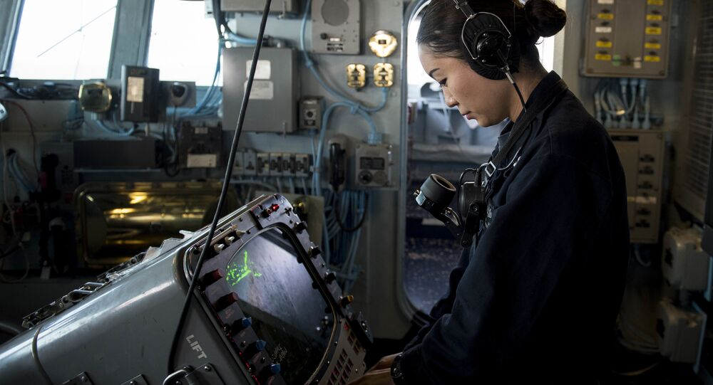 Operations Specialist 3rd Class Han Kalt, from Sichuan Province, China, monitors a radar screen. (File)