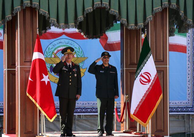 Turkish Chief of Staff General Hulusi Akar meets with his Iranian counterpart Major General Mohammad Baqeri in Tehran, Iran, October 2, 2017