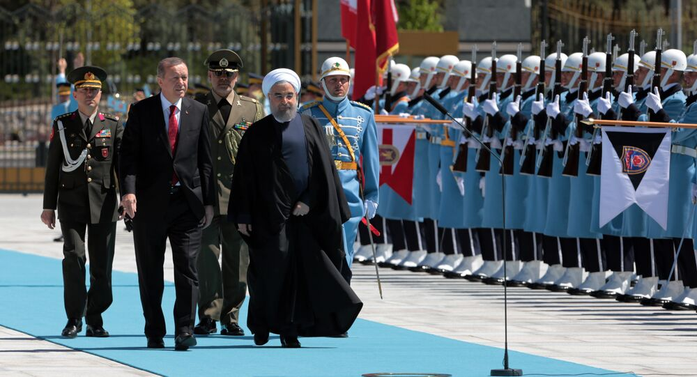 Turkey's President Recep Tayyip Erdogan, left, and Iran's President Hassan Rouhani inspect a military honour guard during a welcome ceremony in Ankara, Turkey, Saturday, April 16, 2016