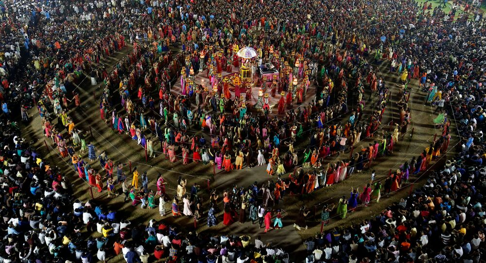 Hindu devotees perform Garba, a traditional folk dance, during the celebrations to mark the Navratri festival, in which devotees worship Hindu goddess Durga, at Surat in the western state of Gujarat, India, September 28, 2017