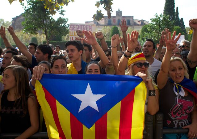 Participants in a general strike in Barcelona in support of Catalan independence referendum