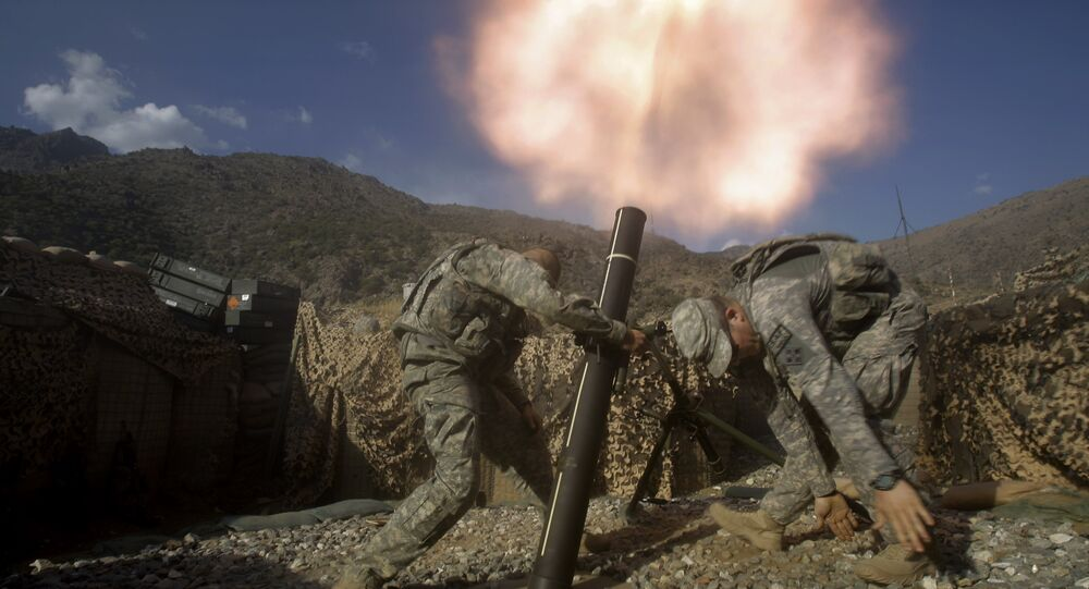 US soldiers from the 2nd Battalion, 12th Infantry Regiment, 4th Brigade Combat Team, fire mortars at known enemy firing positions from a base in the Pech River Valley in Afghanistan's Kunar province, Saturday, Oct. 24, 2009.