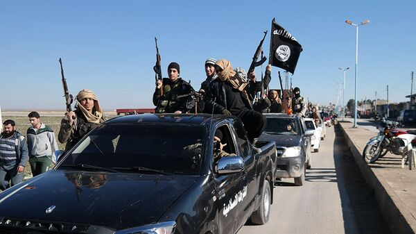 Daesh  terrorists pass by a convoy in Tel Abyad, northeast Syria (File) - Sputnik International