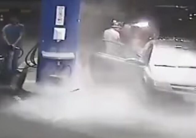 Gas Station Worker Sprays Cigarette Smoker with Fire Extinguisher