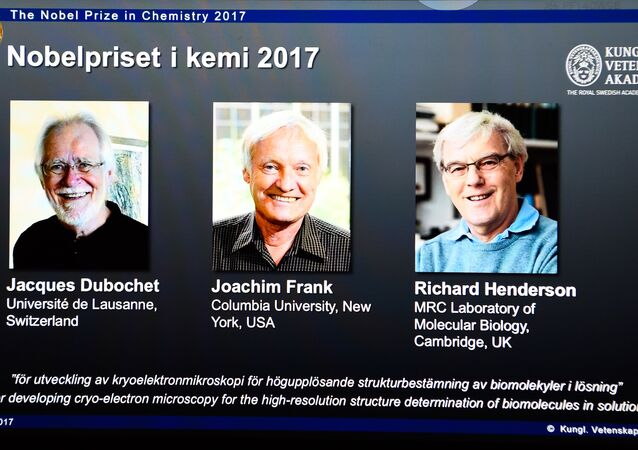 A screen displays portraits of winners of the 2017 Nobel Prize in Chemistry on October 4, 2017 at the Royal Swedish Academy of Sciences in Stockholm, Sweden (L-R) Jacques Dubochet from Switzerland, Joachim Frank from the US and Richard Henderson from Britain
