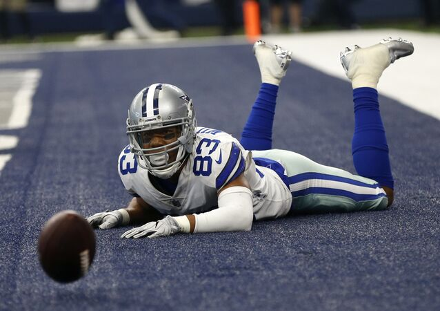 Dallas Cowboys wide receiver Terrance Williams (83) looks at the ball after Williams dropped a pass in the end zone on a two-point conversion attempt late in the second half of an NFL football game against the Los Angeles Rams on Sunday, Oct. 1, 2017, in Arlington, Texas.