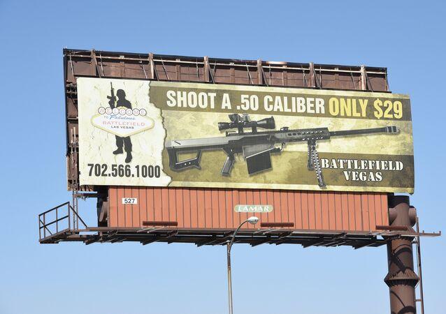 A billboard advertises a gun shooting range in Las Vegas, Nevada on October 4, 2017
