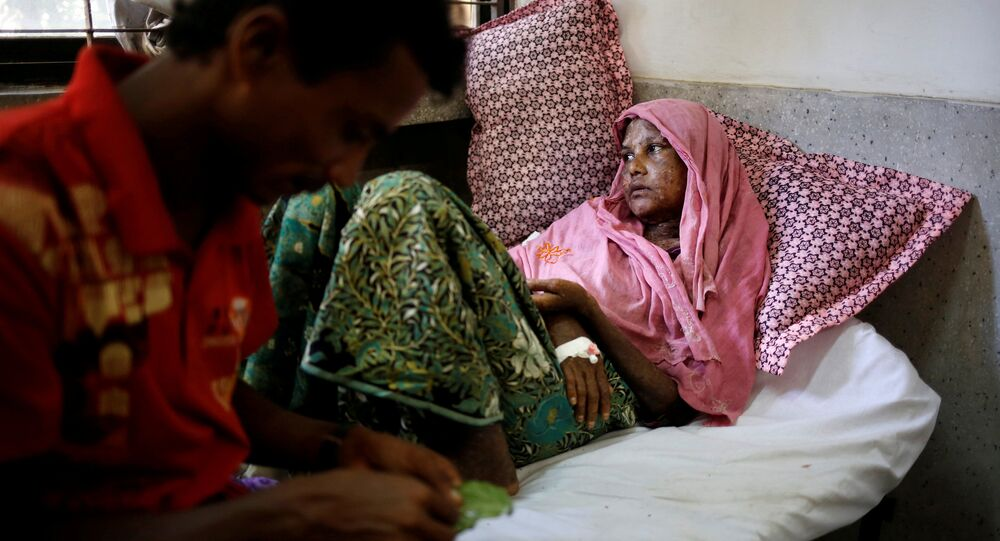 Shaheda, 40, a Rohingya refugee woman who said her body was burnt when the Myanmar army set fire to her house, receives treatment at the Cox's Bazar District Sadar Hospital in Cox's Bazar, Bangladesh, September 13, 2017