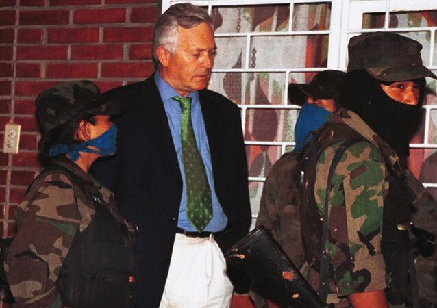 Former German spy chief, Bernd Schmidbauer talks to rebels of the National Liberation Army (ELN) during the release of 33 hostages in El Cedro, in the mountainous region of Jamundi, Tuesday, June. 15, 1999.