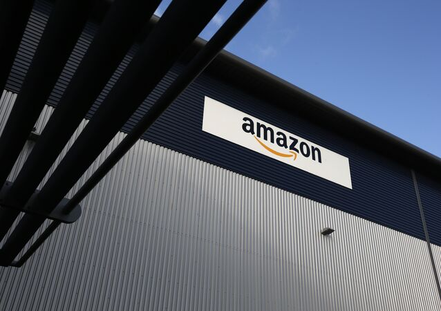 An Amazon logo hangs on a wall outside an Amazon.co.uk fulfillment centre in Hemel Hempstead, north of London. File photo
