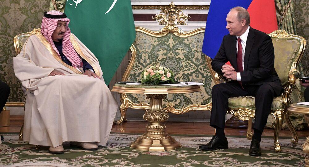 Russian President Vladimir Putin (R) meets with Saudi Arabia's King Salman in the Kremlin in Moscow, Russia
