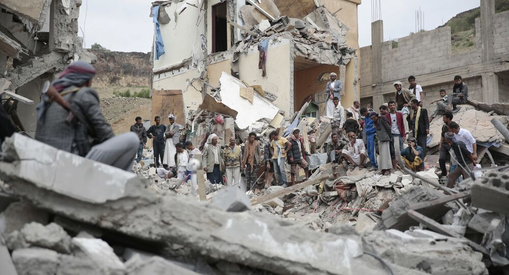 People inspect the rubble of houses destroyed by Saudi-led airstrikes in Sanaa, Yemen, Friday, Aug. 25, 2017