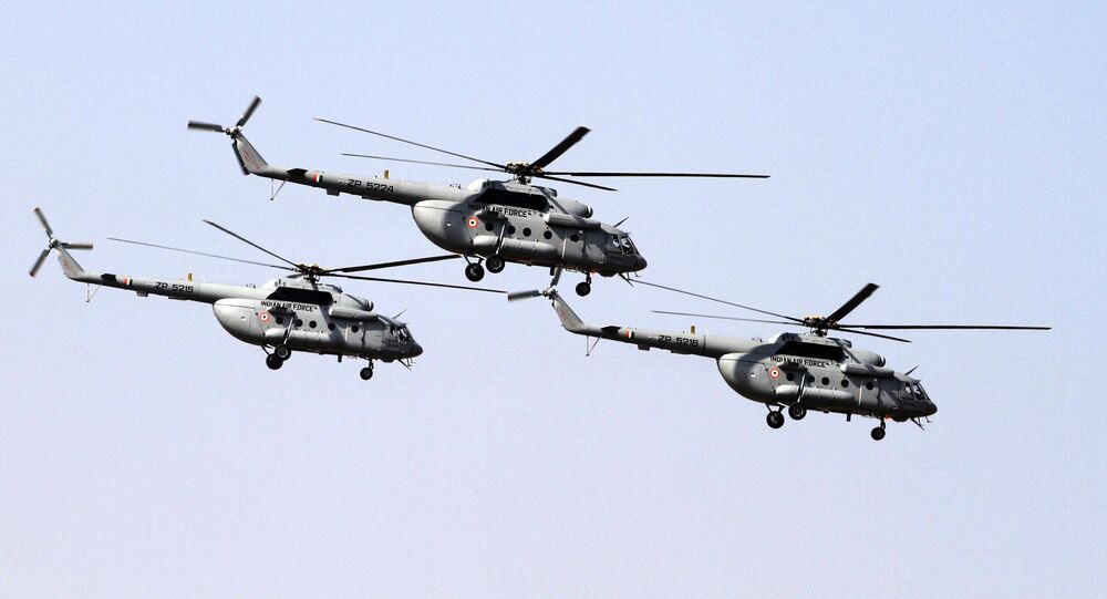 Indian Air Force's Mi- 17 V5 helicopters fly-past during President's standard and colour presentation at Air Force station in Jamnagar, India, Friday, March 4, 2016