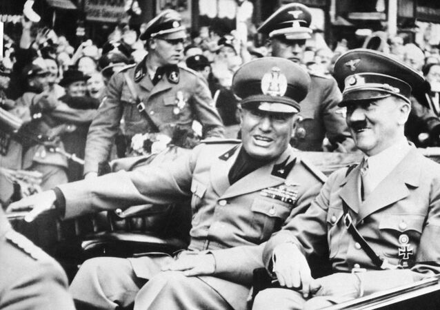 FILE - File photo dated Sept. 28, 1938 showing Italian dictator Benito Mussolini, at left in foreground, and Nazi leader Adolf Hitler, at right, taken just before the four power conference in Munich, Germany