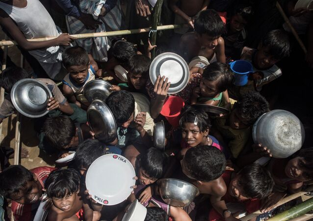Rohingya Muslim refugees children rush to line up at a food distribution in Balukhali refugee camp near Gumdhum on September October 1, 2017
