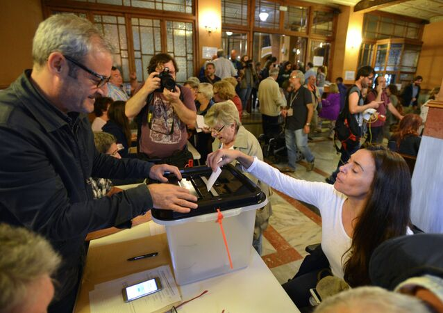 Voting at a polling station in Barcelona during a referendum on Catalonia's independence. File photo
