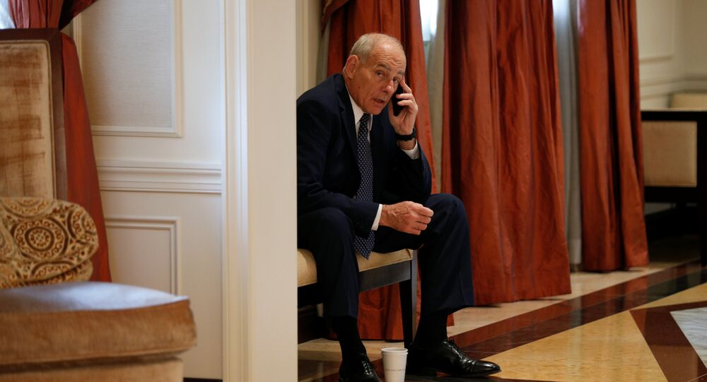 White House Chief of Staff John Kelly speaks on his phone in a hallway outside the room where U.S. President Donald Trump was meeting with Ukraine President Petro Poroshenko during the U.N. General Assembly in New York, U.S., September 21, 2017.