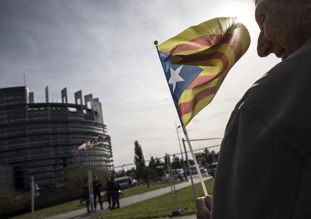 A demonstrator waves a Catalan flag in support of the disputed independence vote Sunday in Catalonia during a gathering in front of the European Parliament in Strasbourg, eastern France, Wednesday, Oct. 4, 2017