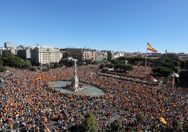 People take part in a pro-union demonstration in Madrid, Spain, October 7, 2017