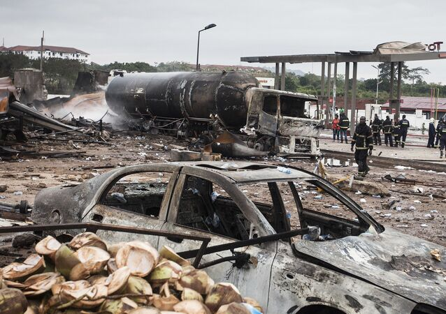 Firemen at the site of Saturday's gas tanker explosion in Accra, Ghana. Sunday Oct. 8, 2017