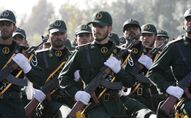In this picture taken on Sunday, Sept. 21, 2008, Iranian Revolutionary Guards members march during a parade ceremony, marking the 28th anniversary of the onset of the Iran-Iraq war (1980-1988), in front of the mausoleum of the late revolutionary founder Ayatollah Ruhollah Khomeini, just outside Tehran, Iran