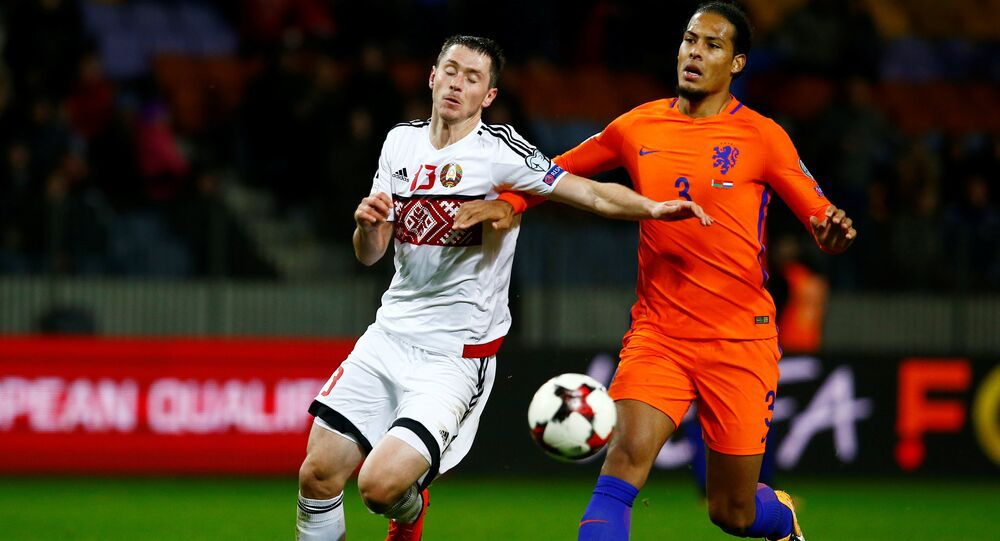 Netherlands' Virgil van Dijk in action with Belarus' Nikolai Signevich