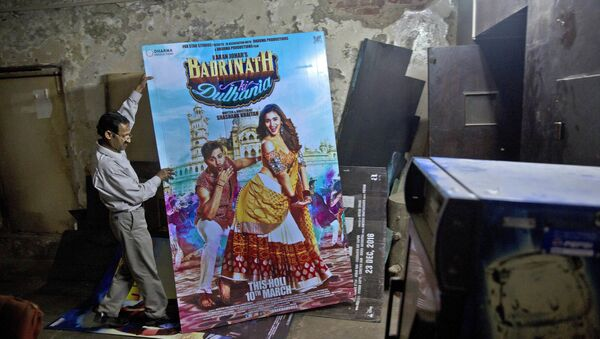In this Tuesday, March 28, 2017 photo, an employee places a poster of a Bollywood film in the dump room of Regal Theater in New Delhi, India - Sputnik International
