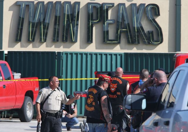 In this May 17, 2015, file photo, authorities investigate a shooting in the parking lot of the Twin Peaks restaurant in Waco, Texas.