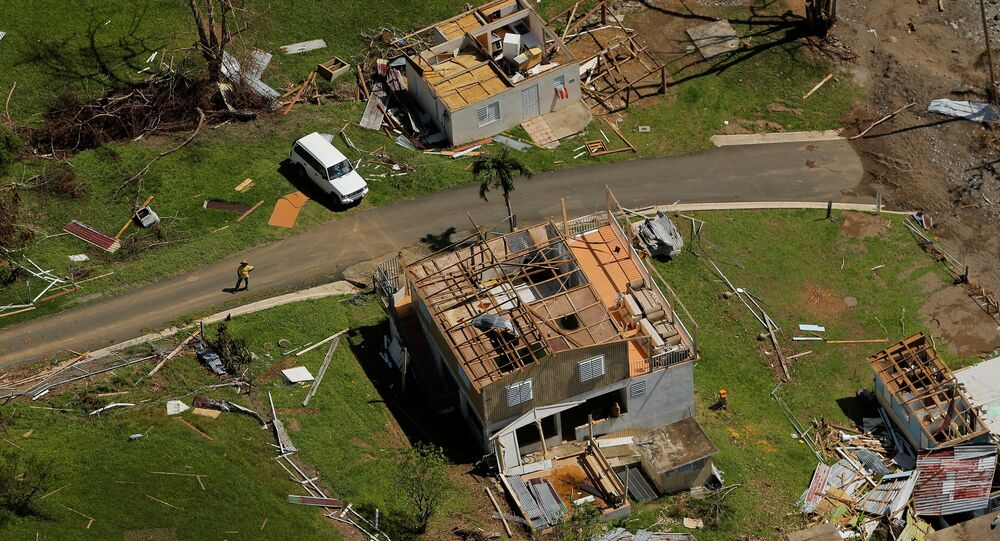 Damaged homes are seen as recovery efforts continue following Hurricane Maria near Ciales, Puerto Rico, October 7, 2017