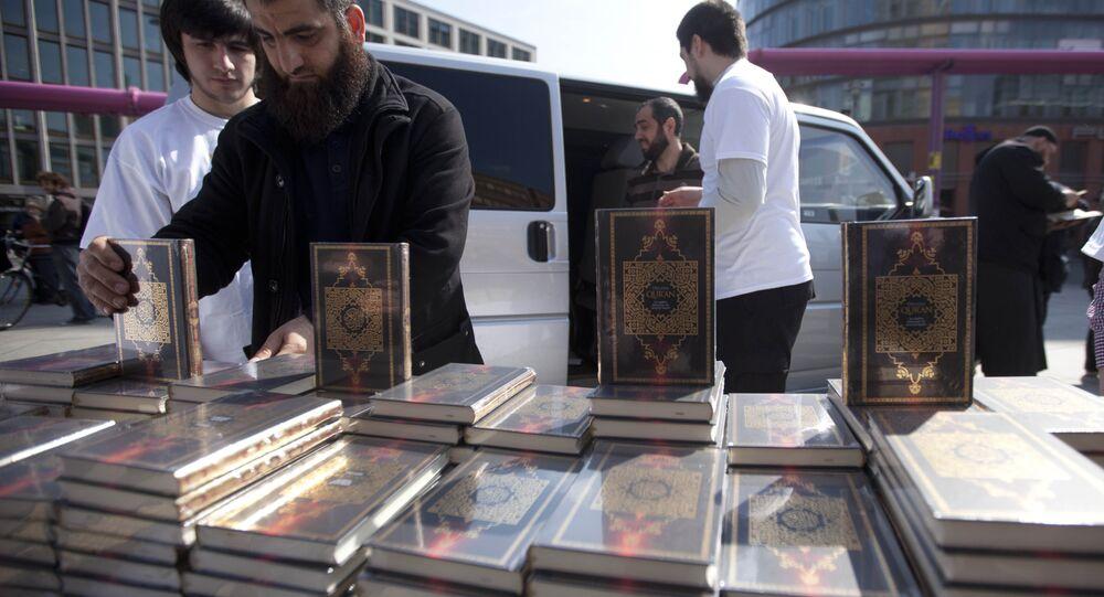 Members of a Muslim group pile Qurans while distributing copies of it at Potsdamer Platz in Berlin. (File)