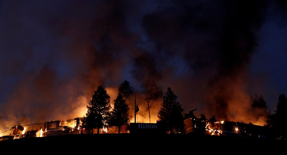 Smoke and flame rise from the Hilton Sonoma Wine Country during the Tubbs Fire in Santa Rosa, California, U.S.