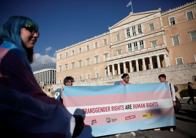 Protesters take part in a demonstration as the Greek Parliament debates bill allowing people to choose legal gender, in Athens, Greece, October 9, 2017.