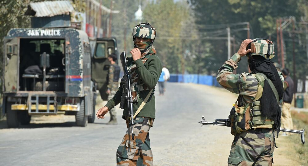 Indian paramilitary troopers stands guard after a gunfight with militants at Hajin village of Kashmir's Bandipora district, north of Srinagar