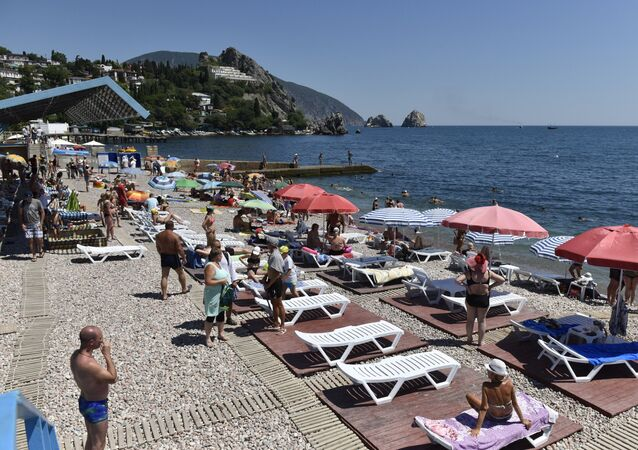 Vacationers on a beach in Gurzuf