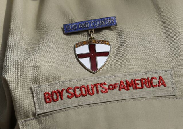 File - In this Feb. 4, 2013 file photo, shows a close up detail of a Boy Scout uniform worn during a news conference in front of the Boy Scouts of America headquarters in Irving, Texas.