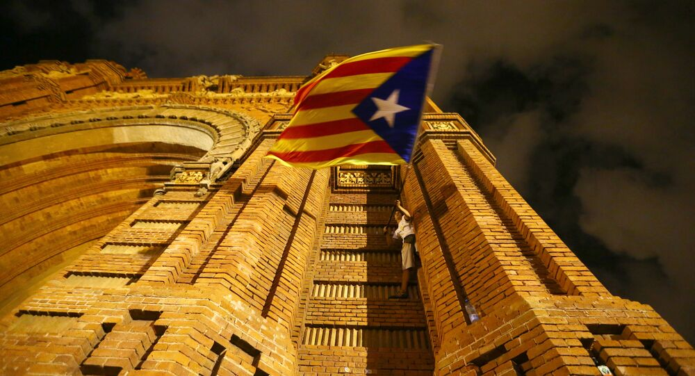 A man waves a separatist Catalonian flag at a pro-independence rally in Barcelona, Spain, October 10, 2017