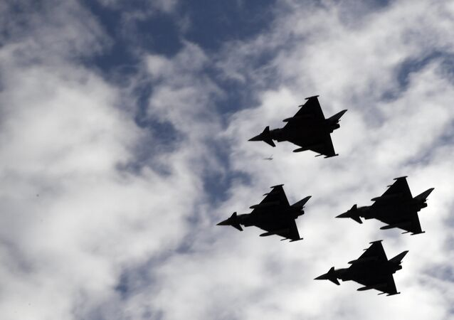 Spanish Eurofighter planes fly during the Spanish National Day military parade in Madrid