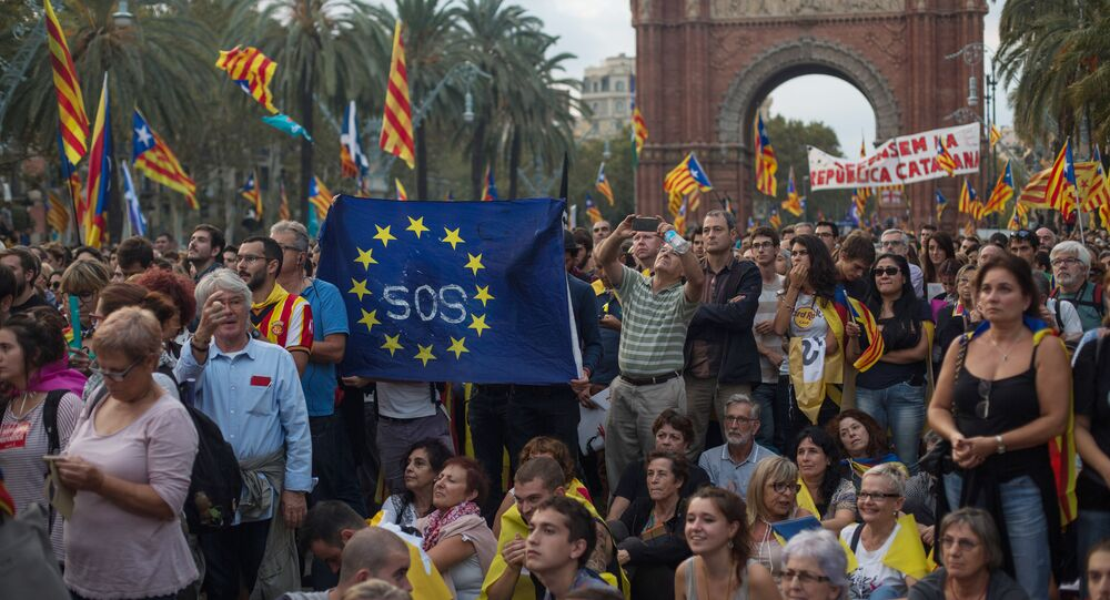 Barcelona residents wait for the parliament to announce the Catalan independence referndum results