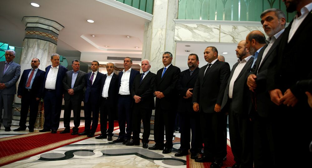 Hamas and Fatah officials pose during a reconciliation ceremony in Cairo, Egypt