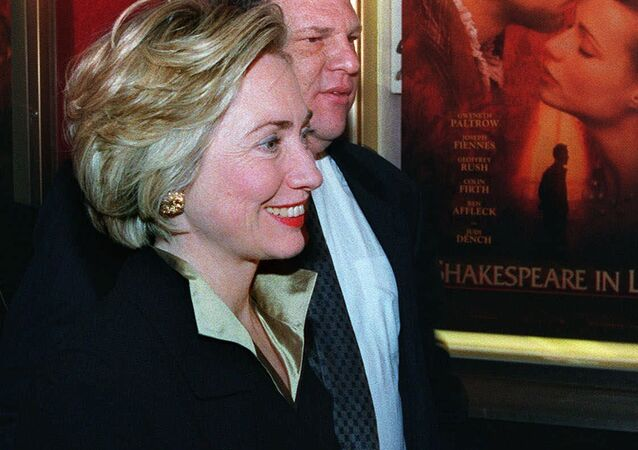 First lady Hillary Rodham Clinton walks with Miramax Co-Chairman Harvey Weinstein into the premier of her new movie Shakespeare in Love, in New York. (File)