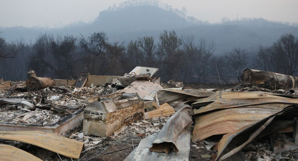 A structure destroyed by wildfire smolders outside Calistoga, California, U.S. October 12, 2017.