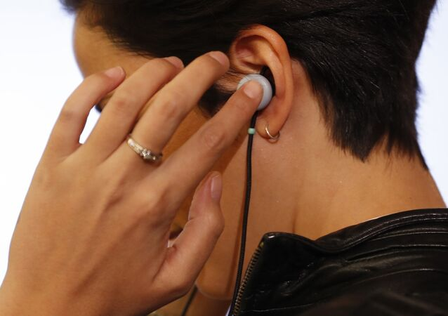 A man tries on a pair of Google Pixel Buds headphones during a launch event in San Francisco, California, U.S. October 4, 2017