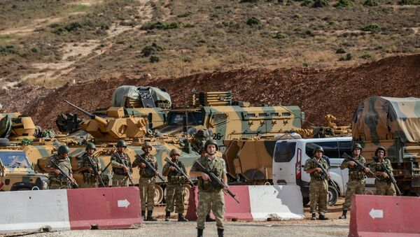 Turkish soldiers stand near armoured vehicles during a demonstration in support of the Turkish army's Idlib operation near the Turkey-Syria border near Reyhanli, Hatay, on October 10, 2017 - Sputnik International