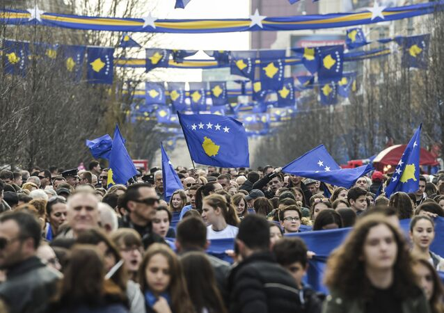 People wave flags and carry banners as they gather in Pristina on February 17, 2017 during the celebrations marking the 9th anniversary of Kosovo's declaration of independence