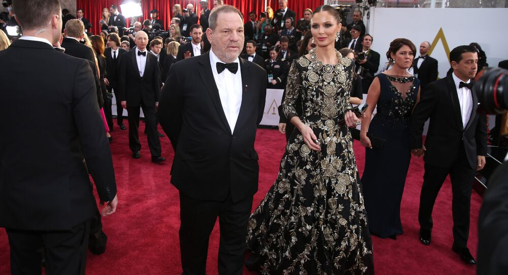 Harvey Weinstein, left and Georgina Chapman arrive at the Oscars on Sunday, Feb. 22, 2015, at the Dolby Theater in Los Angeles.