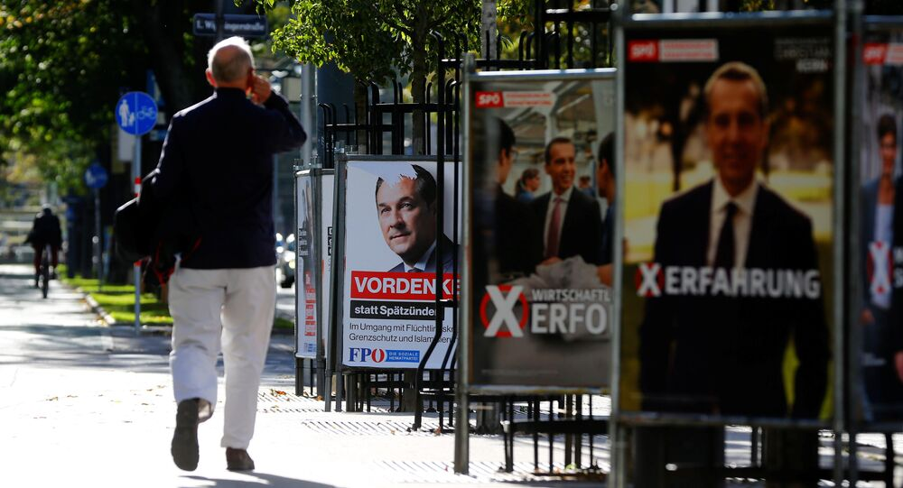 A man walks past an election campaign posters of top candidate of Social Democratic Party of Austria (SPOe) and Austrian Chancellor Christian Kern and far-right Freedom Party of Austria (FPOe) head and top candidate Heinz-Christian Strache in Vienna, Austria, October 5, 2017