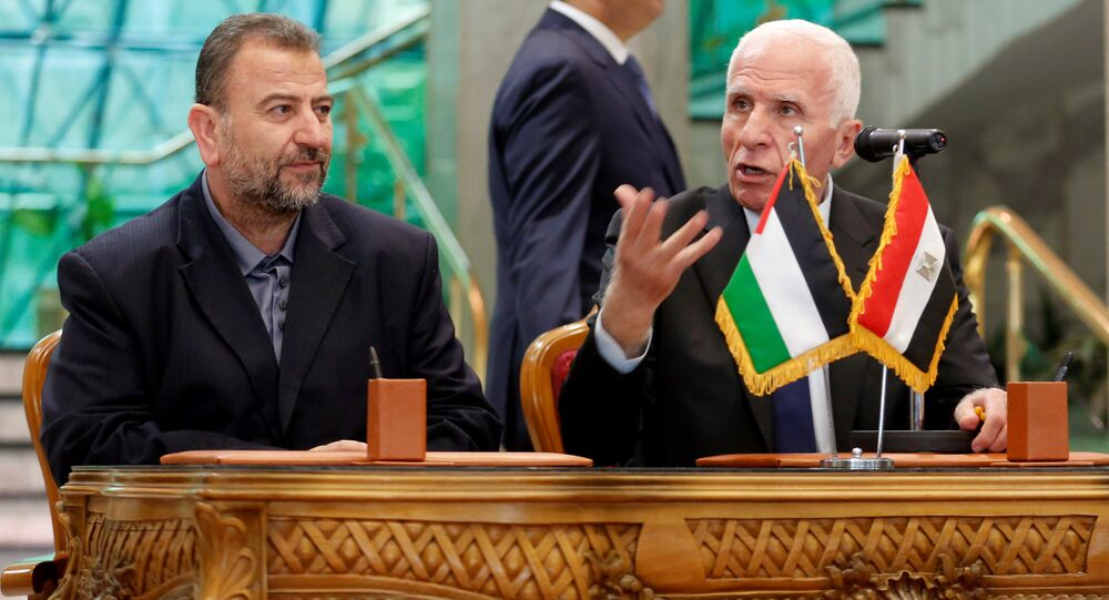 Head of Hamas delegation Saleh Arouri and Fatah leader Azzam Ahmad attend a reconciliation deal signing ceremony in Cairo, Egypt, October 12, 2017.