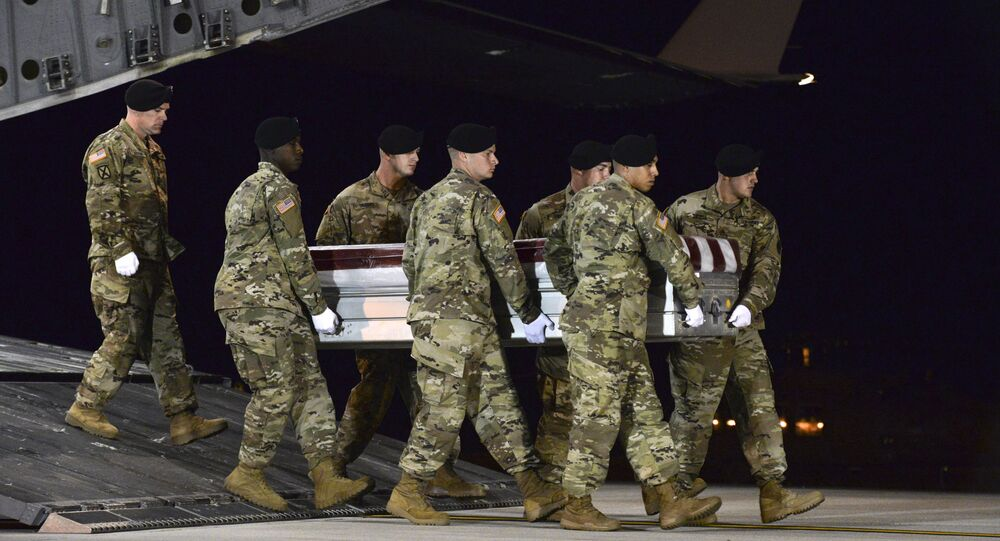 In this image provided by the US Air Force, a US Army carry team transfers the remains of Army Staff Sgt. Dustin Wright of Lyons, Ga., late Thursday, Oct. 5, 2017, upon arrival at Dover Air Force Base, Del. Wright, 29, of Lyons, Ga., was one of four US troops and four Niger forces killed in an ambush by dozens of Islamic extremists on a joint patrol of American and Niger Force.