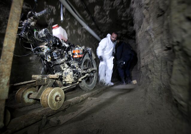 A motorcycle adapted to a rail sits in the tunnel under the half-built house where according to authorities, drug lord Joaquin El Chapo Guzman made his escape from the Altiplano maximum security prison in Almoloya, west of Mexico City, Thursday, July 16, 2015